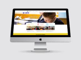 Bentley New Village website design home page on iMac
